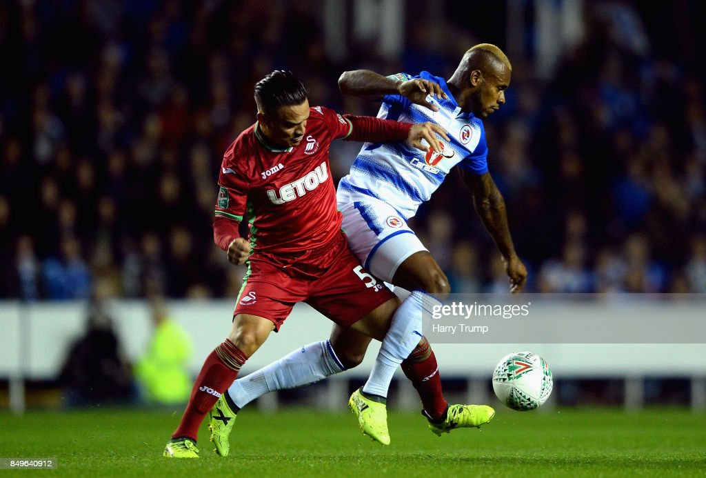 Roque Mesa of Swansea City and Leandro Bacuna of Reading battle for possession during the Carabao Cup Third Round match between Reading and Swansea City at Madejski Stadium on September 19, 2017 in Reading, England.