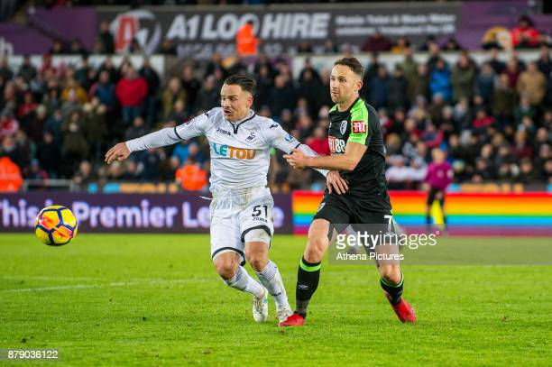 Roque Mesa of Swansea City and Marc Pugh of Bournemouth in action during the Premier League match between Swansea City and Bournemouth at The Liberty...