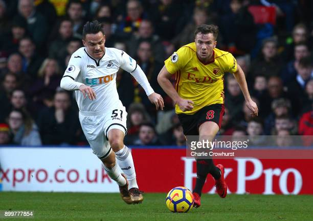 Roque Mesa of Swansea City and Tom Cleverley of Watford battle for possession during the Premier League match between Watford and Swansea City at...