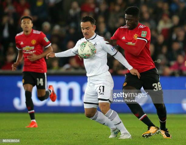 Roque Mesa of Swansea City challenged by Axel Tuanzebe of Manchester United during the Carabao Cup Fourth Round match between Swansea City and...