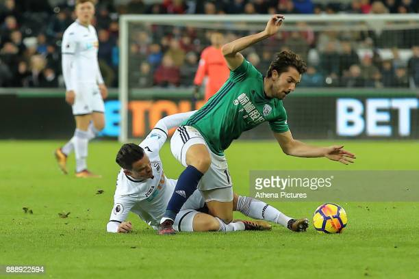 Roque Mesa of Swansea City challenges Jay Rodriguez of West Bromwich Albion during the Premier League match between Swansea City and West Bromwich...