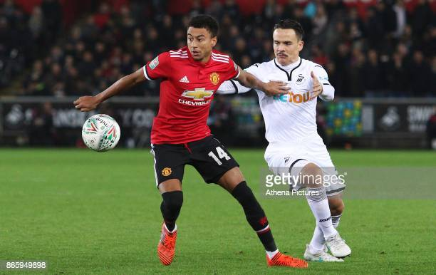 Roque Mesa of Swansea City challenges Jesse Lingard of Manchester United during the Carabao Cup Fourth Round match between Swansea City and...
