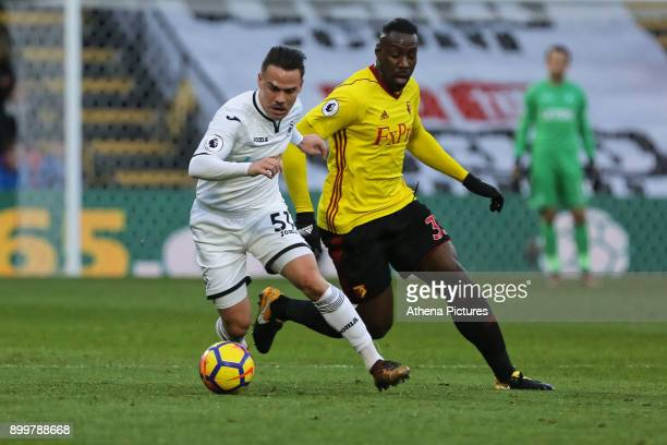 Roque Mesa of Swansea City closely marked by Stefano Okaka of Watford during the Premier League match between Watford and Swansea City at the...