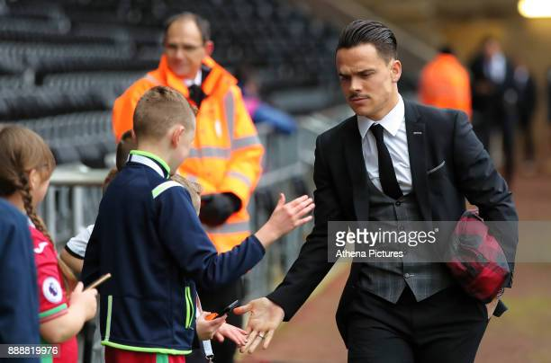 Roque Mesa of Swansea City greets a young supporter as he arrives prior to the game during the Premier League match between Swansea City and West...
