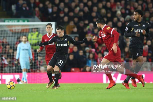 Roque Mesa of Swansea City is challenged by Emre Can of Liverpool during the Premier League match between Liverpool and Swansea City at Anfield on...