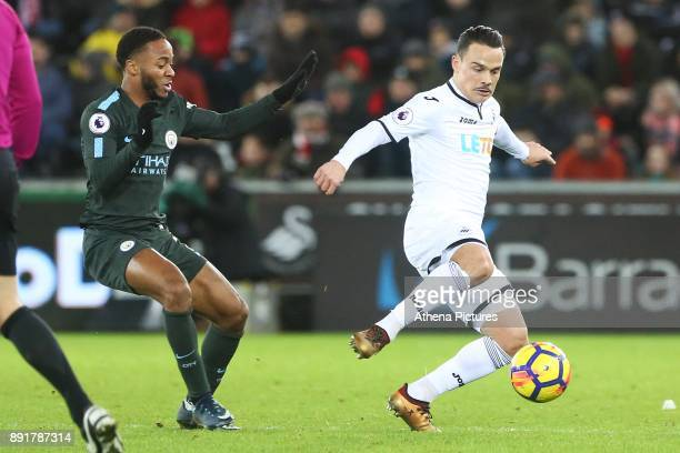 Roque Mesa of Swansea City is marked by Raheem Sterling of Manchester City during the Premier League match between Swansea City and Manchester City...