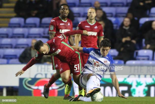Roque Mesa of Swansea City is tackled by George Evans of Reading during the Carabao Cup Third Round match between Reading and Swansea City at...
