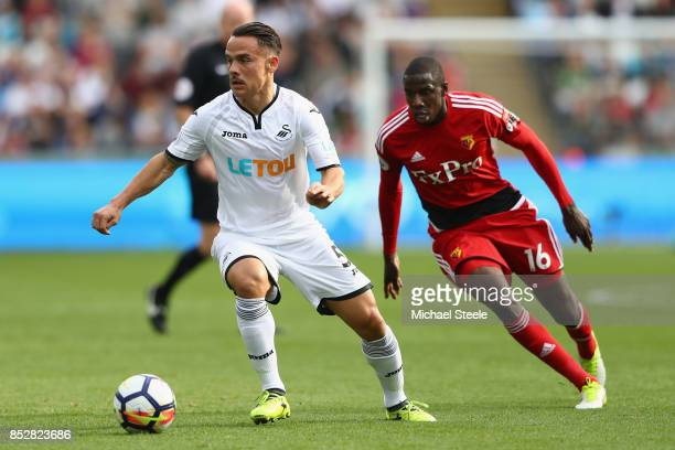Roque Mesa of Swansea City is tracked by Abdoulaye Doucoure of Watford during the Premier League match between Swansea City and Watford at Liberty...