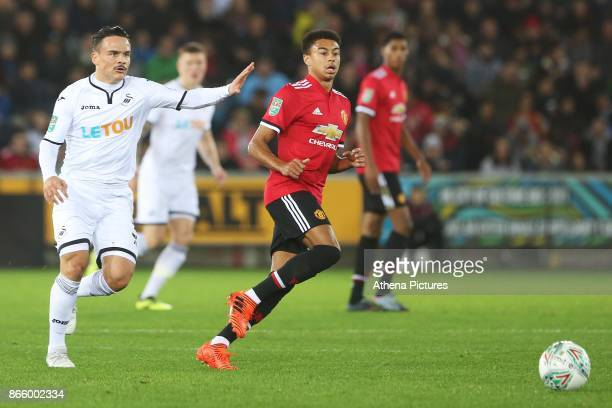 Roque Mesa of Swansea City marks Jesse Lingard of Manchester United during the Carabao Cup Fourth Round match between Swansea City and Manchester...