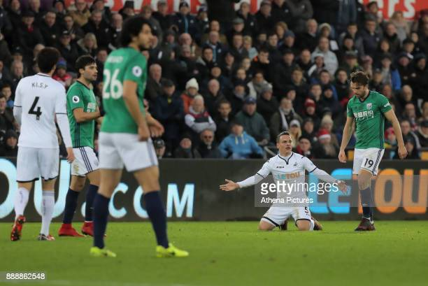 Roque Mesa of Swansea City on the ground protests to referee Mike Dean during the Premier League match between Swansea City and West Bromwich Albion...