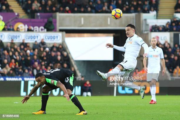 Roque Mesa of Swansea City wins the aerial ball under pressure from Callum Wilson of Bournemouth during during the Premier League match between...
