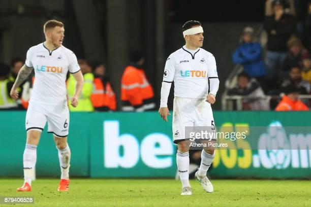 Roque Mesa of Swansea City with his head bandaged after cutting it during the Premier League match between Swansea City and Bournemouth at the...