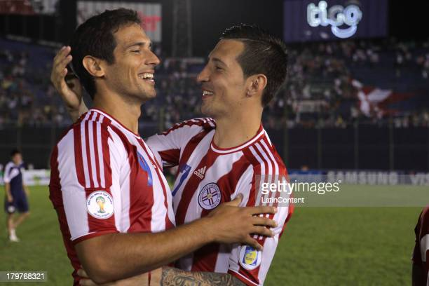 Roque Santa Cruz and Jonathan Fabbro of Paraguay celebrate after a match between Paraguay and Bolivia as part of the 15th round of the South American...