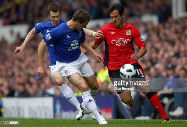 Roque Santa Cruz of Blackburn Rovers attempts to move away from Diniyar Bilyaletdinov and Phil Jagielka of Everton during the Barclays Premier League...