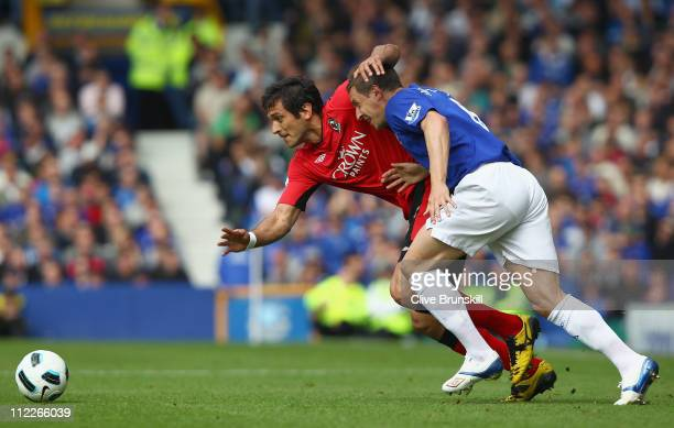 Roque Santa Cruz of Blackburn Rovers attempts to move away from Phil Jagielka of Everton during the Barclays Premier League match between Everton and...