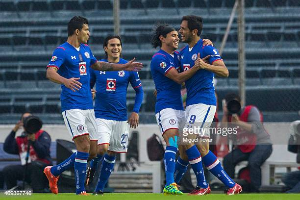 Roque Santa Cruz of Cruz Azul celebrates with his teammates after scoring the first goal of his team during a match between Cruz Azul and Tigres UANL...