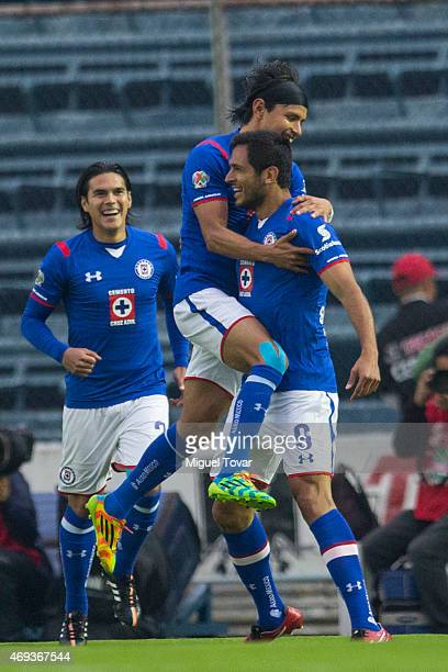 Roque Santa Cruz of Cruz Azul celebrates with teammates after scoring the first goal of his team during a match between Cruz Azul and Tigres UANL as...
