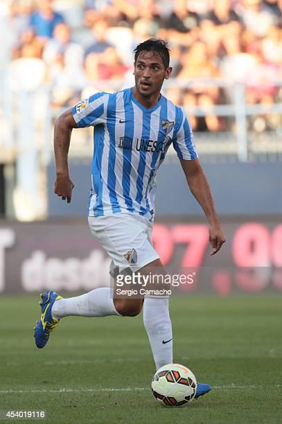 Roque Santa Cruz of Malaga CF runs whit the ball during the La Liga match between Malaga CF and Athletic Club Bilbao at La Rosaleda Stadium on August...