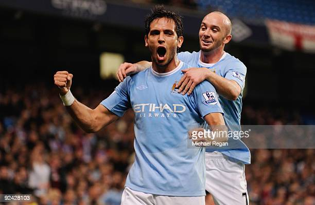 Roque Santa Cruz of Manchester City celebrates scoring to make it 2-1 with Stephen Ireland during the Carling Cup 4th Round match at the City of...