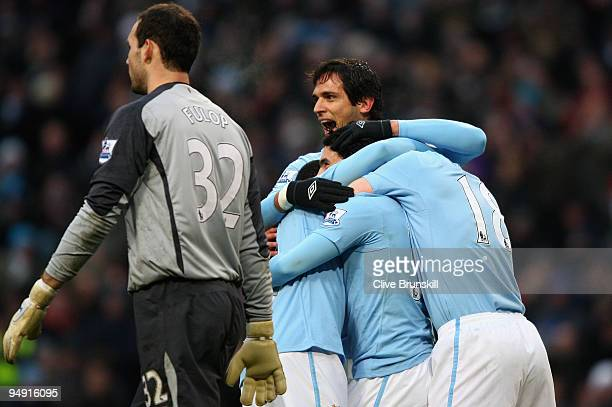 Roque Santa Cruz of Manchester City celebrates with Carlos Tevez and teammates after Tevez scored the 2:0 goal from the penalty spot past...