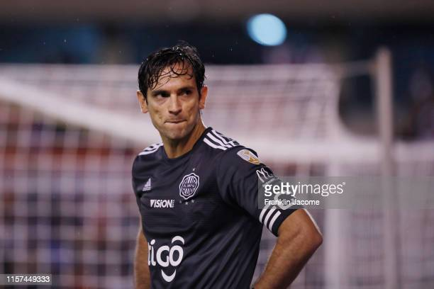 Roque Santa Cruz of Olimpia reacts after losing the round of sixteen first leg match between LDU Quito and Olimpia as part of Copa CONMEBOL...