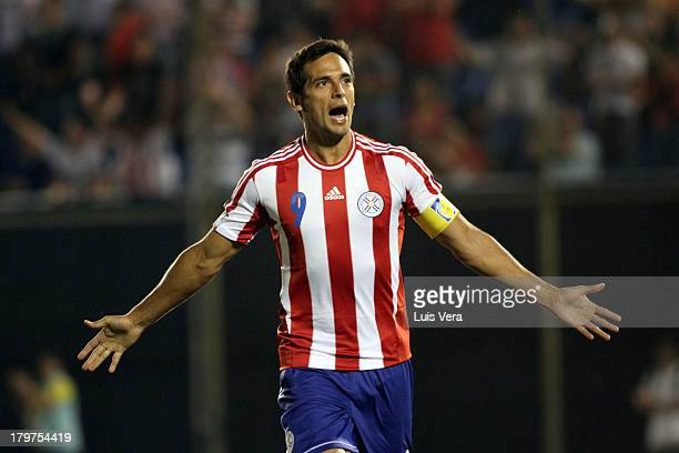 Roque Santa Cruz of Paraguay celebrates the second goal during a match between Paraguay and Bolivia as part of the 15th round of the South American...