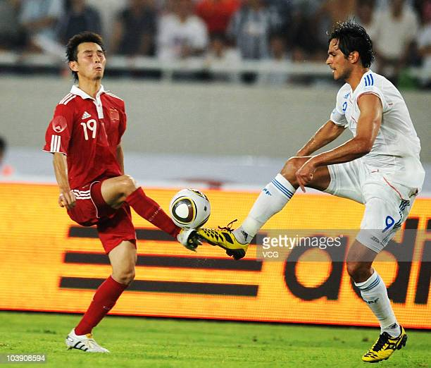 Roque Santa Cruz of Paraguay football team fights for the ball with Yang Hao of China football team during the 2010 International Friendly Match...