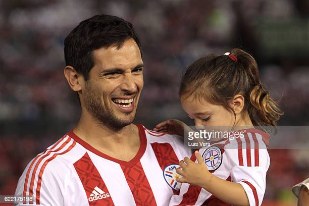 Roque Santa Cruz of Paraguay is honored prior a match between Paraguay and Peru as part of FIFA 2018 World Cup Qualifiers at Defensores del Chaco...