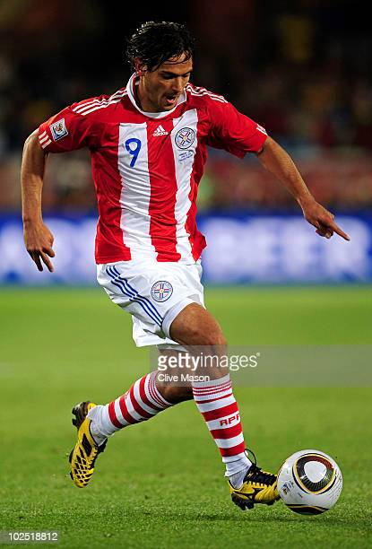 Roque Santa Cruz of Paraguay runs with the ball during the 2010 FIFA World Cup South Africa Round of Sixteen match between Paraguay and Japan at...