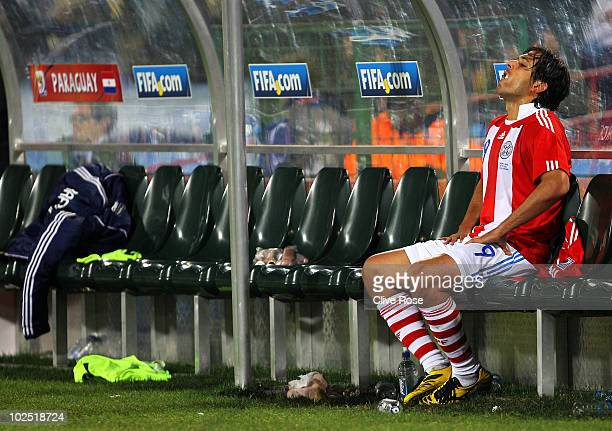 Roque Santa Cruz of Paraguay sits on the substitutes bench after being taken off during the 2010 FIFA World Cup South Africa Round of Sixteen match...
