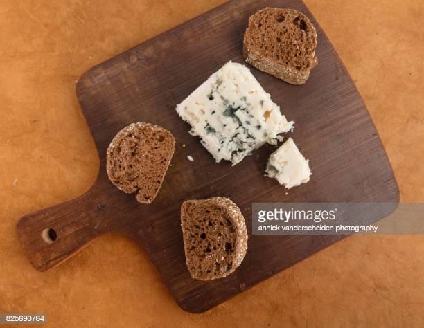 Roquefort piece and cut baguette.