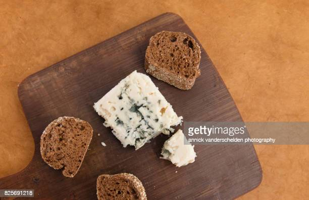roquefort piece and cut baguette. - roquefort cheese stock photos and pictures