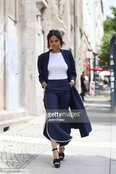 Roro Stone, wearing a vintage coat, Zara trousers and vintage shoes is seen during the Mercedes-Benz Fashion Week Berlin Spring/Summer 2018 at...