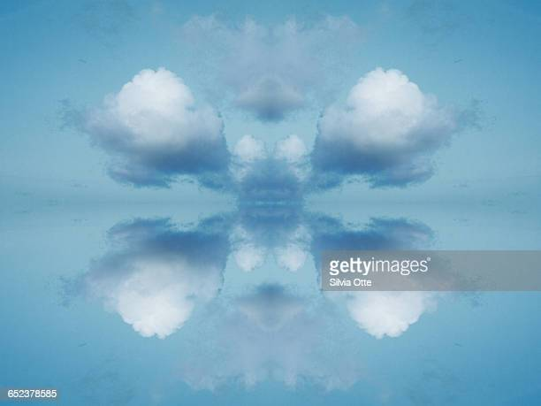 Rorschach collage of fluffy white clouds in heaven