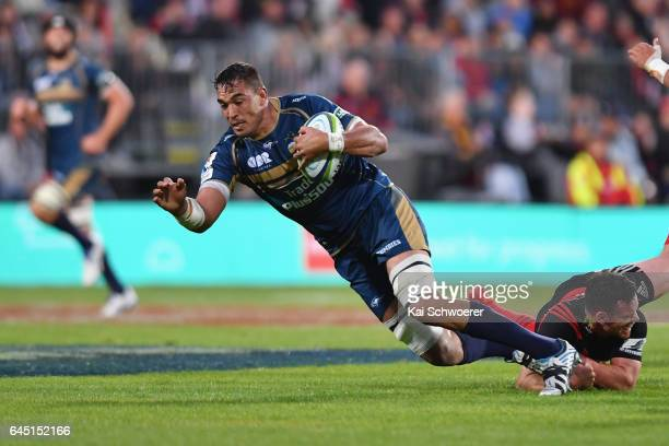 Rory Arnold of the Brumbies is tackled by Ryan Crotty of the Crusaders during the round one Super Rugby match between the Crusaders and the Brumbies...