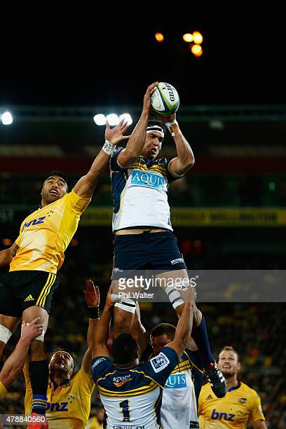 Rory Arnold of the Brumbies takes the ball in the lineout under pressure from Victor Vito of the Hurricanes during the Super Rugby Semi Final match...