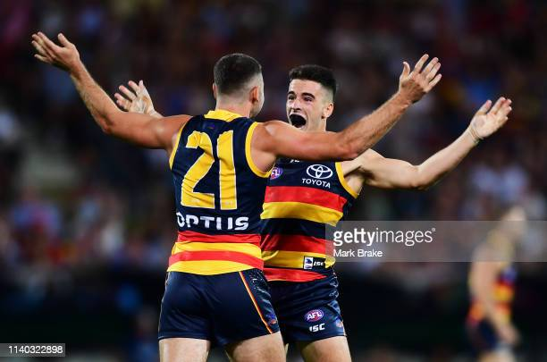 Rory Atkins of the Adelaide Crows celebrates a goal with Lachlan Murphy of the Adelaide Crows during the round three AFL match between the Adelaide...