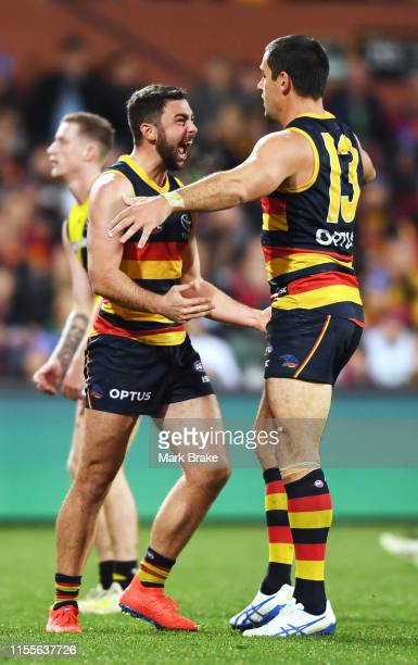 Rory Atkins of the Adelaide Crows celebrates a goal with Taylor Walker of the Adelaide Crows during the round 13 AFL match between the Adelaide Crowd...