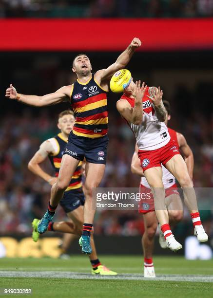 Rory Atkins of the Crows contests the ball Zak Jones of the Swans during the round five AFL match between the Sydney Swans and the Adelaide Crows at...