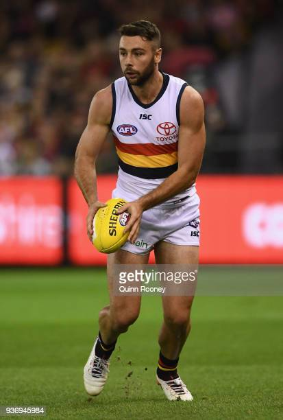 Rory Atkins of the Crows kicks during the round one AFL match between the Essendon Bombers and the Adelaide Crows at Etihad Stadium on March 23 2018...