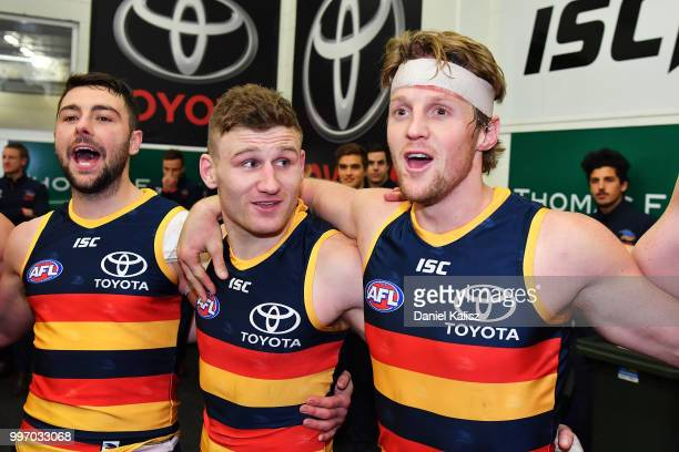 Rory Atkins of the Crows Rory Laird of the Crows and Rory Sloane of the Crows sing the club song after the round 17 AFL match between the Adelaide...