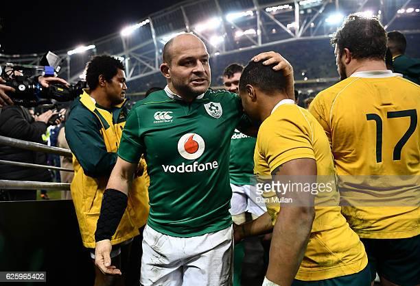 Rory Best of Ireland consoles Will Genia of Australia following the international match between Ireland and Australia at the Aviva Stadium on...