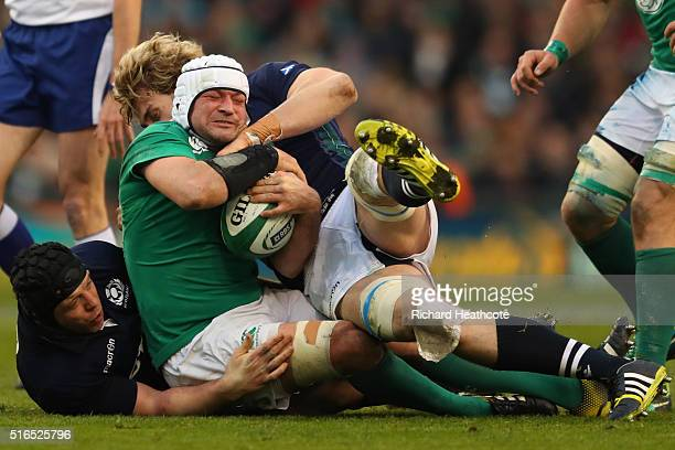 Rory Best of Ireland is hauled down by Alasdair Dickinson and Richie Gray of Scotland during the RBS Six Nations match between Ireland and Scotland...