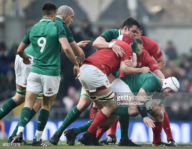 Rory Best of Ireland is tackled shy of the goal line during the Six Nations Championship rugby match between Ireland and Wales at Aviva Stadium on...