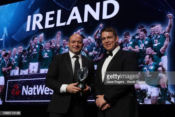 Rory Best of Ireland on behalf of Ireland receives the World Rugby via Getty Images Team of the Year award from John Smit during the World Rugby via...