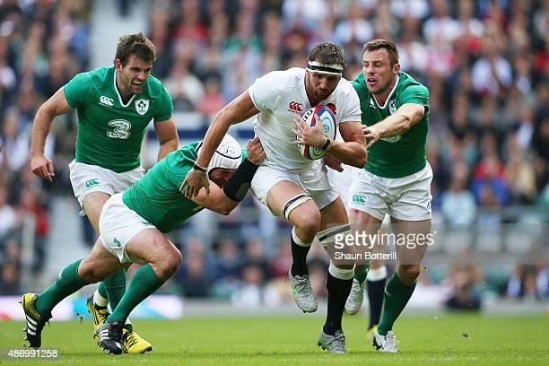 Rory Best of Ireland tackles Tom Wood of England during the QBE International match between England and Ireland at Twickenham Stadium on September 5...