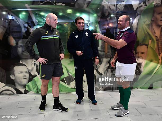 Rory Best of Ireland tosses the coin alongside Stephen Moore of Australia and Referee Jerome Garces during the international match between Ireland...