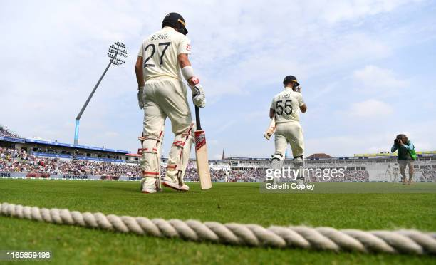 Rory Burns and Ben Stokes of England walk out to bat ahead of day three of the 1st Specsavers Ashes Test between England and Australia at Edgbaston...