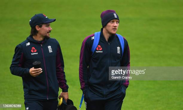Rory Burns and Dom Bess of England walk across the outfield prior to a England Nets Session at Emirates Old Trafford on August 04 2020 in Manchester...
