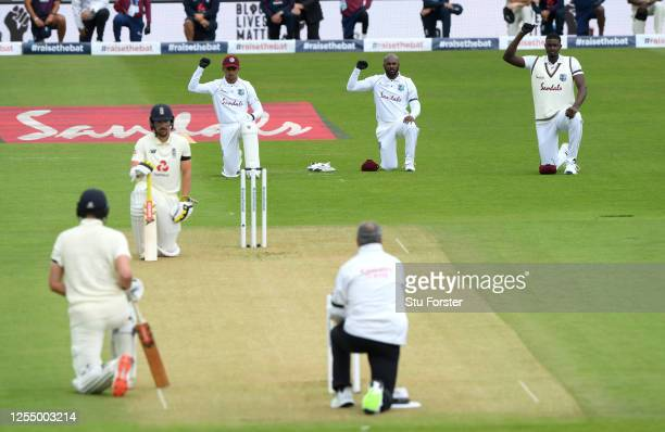 Rory Burns and Dom Sibley of England take a knee alongside Shane Dowrich, Jermaine Blackwood and Jason Holder of the West Indies during day one of...